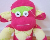 Argyle sock monkey plush doll - magenta, lime green, and pale yellow