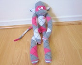 Preppy pink, gray, and white argyle sock monkey plush with pink heart