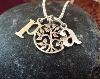 Customized necklace with alphabet charms and tree of life pendant
