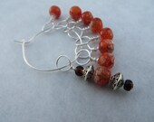 Wire knitting stitch markers no snags.  Orange glass beads.  Set of 7!