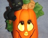 Hand-Painted Black Cat Climbing a Pumpkin Jack O Lantern comes with a switch light too