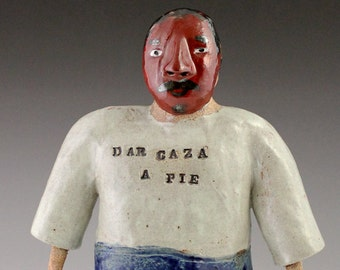 Border Monster Ceramic Figurative sculpture with traditional Moor Mask