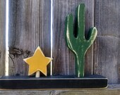 ONE Wooden cactus shelf sitter with a little star
