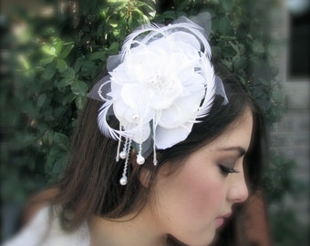 White pearls in a rose bride comb