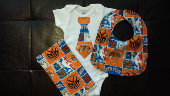 In our wide variety of Knicks clothing and accessories, you'll find items for every room of the home: game room décor, bed and bath items, kitchen and dining accessories, Knicks flags and outdoor decor, and much more. You don't have to spend an arm and a leg to express your loyalty for the New York Knicks.