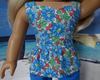 Brightly flowered peplum top and skinny jeans for American Girl or similar 18 inch doll.