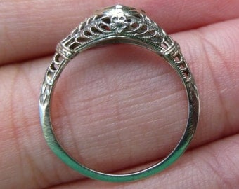 One of a kind  18KT White gold  filigree with a diamond and flowers on the side  Engagment Ring