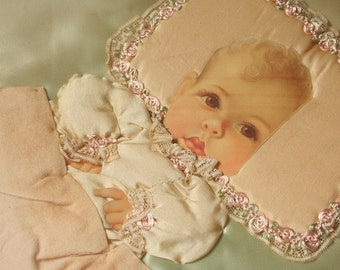 Vintage collage, baby in a crib, hand stitched collage, satin and lace collage, pastel colors