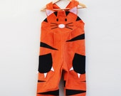 Tiger dungaree overall in orange cord.
