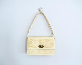 Mexican hand tooled leather handbag . vintage cream leather purse