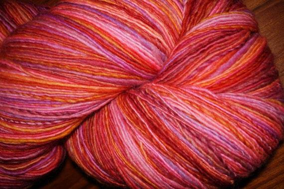 Hand Spun, Hand Dyed Single Ply Merino Wool Yarn, Firey Pinks, Red and Orange, 850 yards.