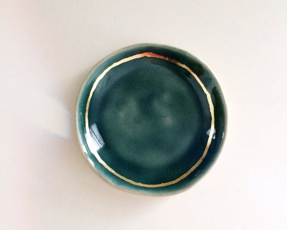 navy blue porcelain ring dish with golden rim