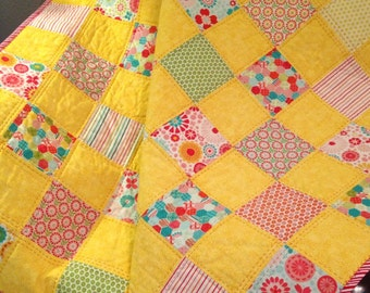 "Bright Yellow, Aqua Red and More, All Together In This 43.5"" X 44.5"" Quilt In The Line Called So Happy By Deena Rutter For Riley Blake"