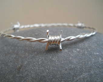 Sterling silver barbed wire bangle.