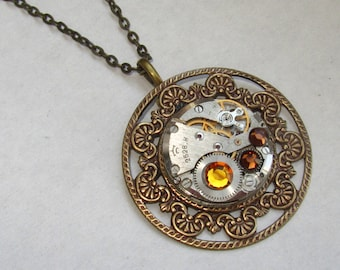 Steampunk Gothic filigree necklace with vintage watch movement and Swarovski crystals Art nouveau necklace. Gift under 30 Dollars
