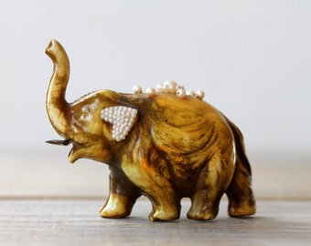 Vintage elephant novelty figural tape measure / mid century kitsch / yellow / brown / faux pearls / eclectic decor / Japan / collectible