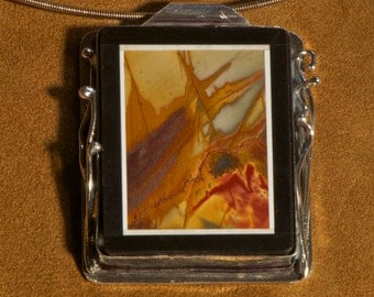 Red Creek Jasper framed in onyx Pendent flanked with sterling reeds and hung from handmade chain