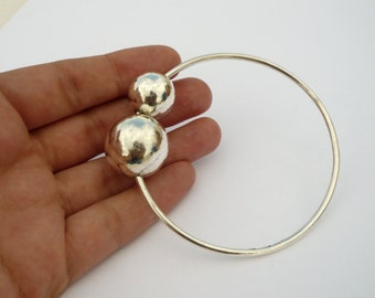handmade sterling silver bangle with two balls