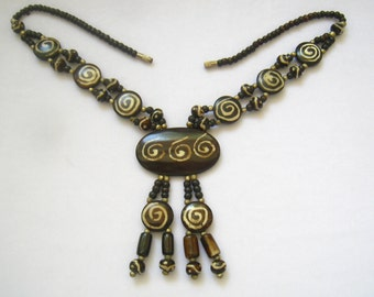 "CLEARANCE African Batik Bone Bead Vintage Tribal Necklace.  Mixed Sized/Shaped Batik Beads.  Large Oval Pendant with 2 Tassels. Over 18"" L"
