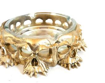 skull ashtray, oddities, skull heads, macabre, metallic gold decor, goth, unique ashtrays