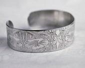 William Morris flower design embossed cuff silver aluminium