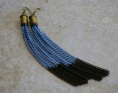 "Long 4 3/4"" Denim Blue and Black Chain 32 Caliber bullet shell earrings."