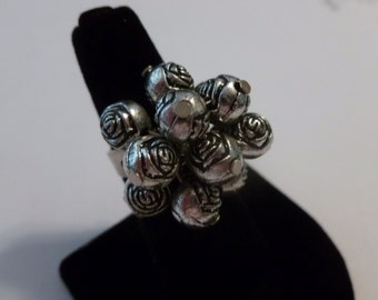 Silver Toned Movement Etched Roses ball ring.