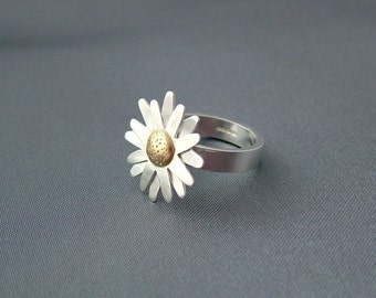 Sterling silver and 18ct gold daisy ring