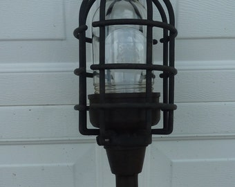 vintage drop light with rubber cage