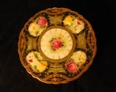 Floral and Heavily Gold-accented Display Plate   p224