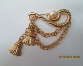 Gold chain and tassel pin with pearl