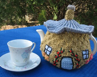 Tiny tea house tea cosy. Crocheted to order you choose what is in the backyard.