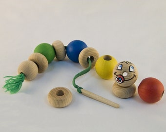 Wooden Lacing toy of caterpillar. Wooden kids toy. Funny eco friendly toys for baby