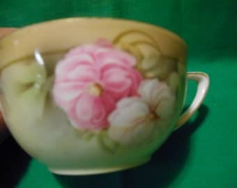One (1), Porcelain Tea Cup, From R S Germany, in a Floral Design Pattern.