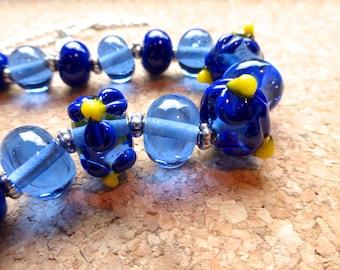 dark blue flower petal bead lampwork glass necklace