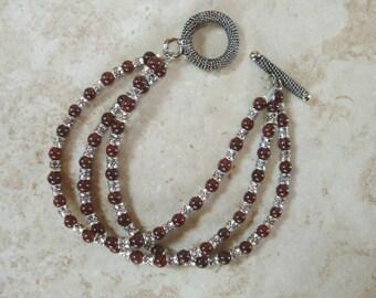 "Garnet & Tibetan Silver Gemstone Beaded 6–3/4""  Three Strand Bracelet"