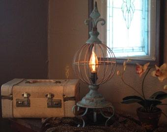 Verdigris fleur de lis globe lamp
