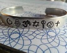 coexist bracelet made of  islam symbol, hamsa, om, david, peace and love, yin yang, ankh or christian cross, gender