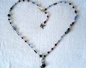 Ebony, Blue, and Burgundy Hand Beaded Silver Wire Necklace.  Tiny flying Bird and Butterfly Accent