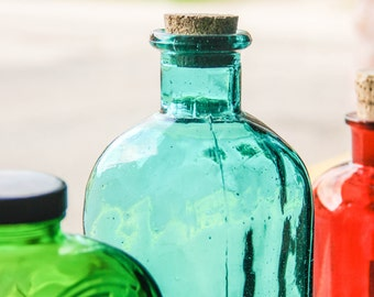 Top Of Colorful Glass Bottles In A Window