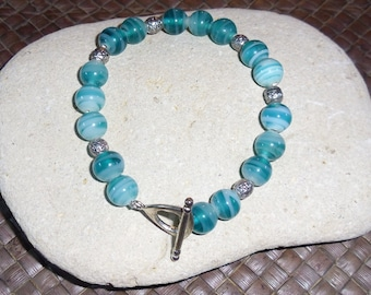 Teal and white striped bracelet