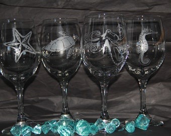 Hand etched wine glasses with Seahorse, Sea turtle, Starfish and Octopus.  All done by hand.  No Chemical creams or stencils used.