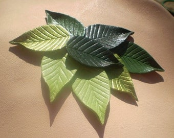 """Green flat 1.25"""" leather leaves."""