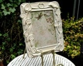 Brass Picture frame, painted old white,floral motif in a french cottage look, distressed, chippy painted metal frame