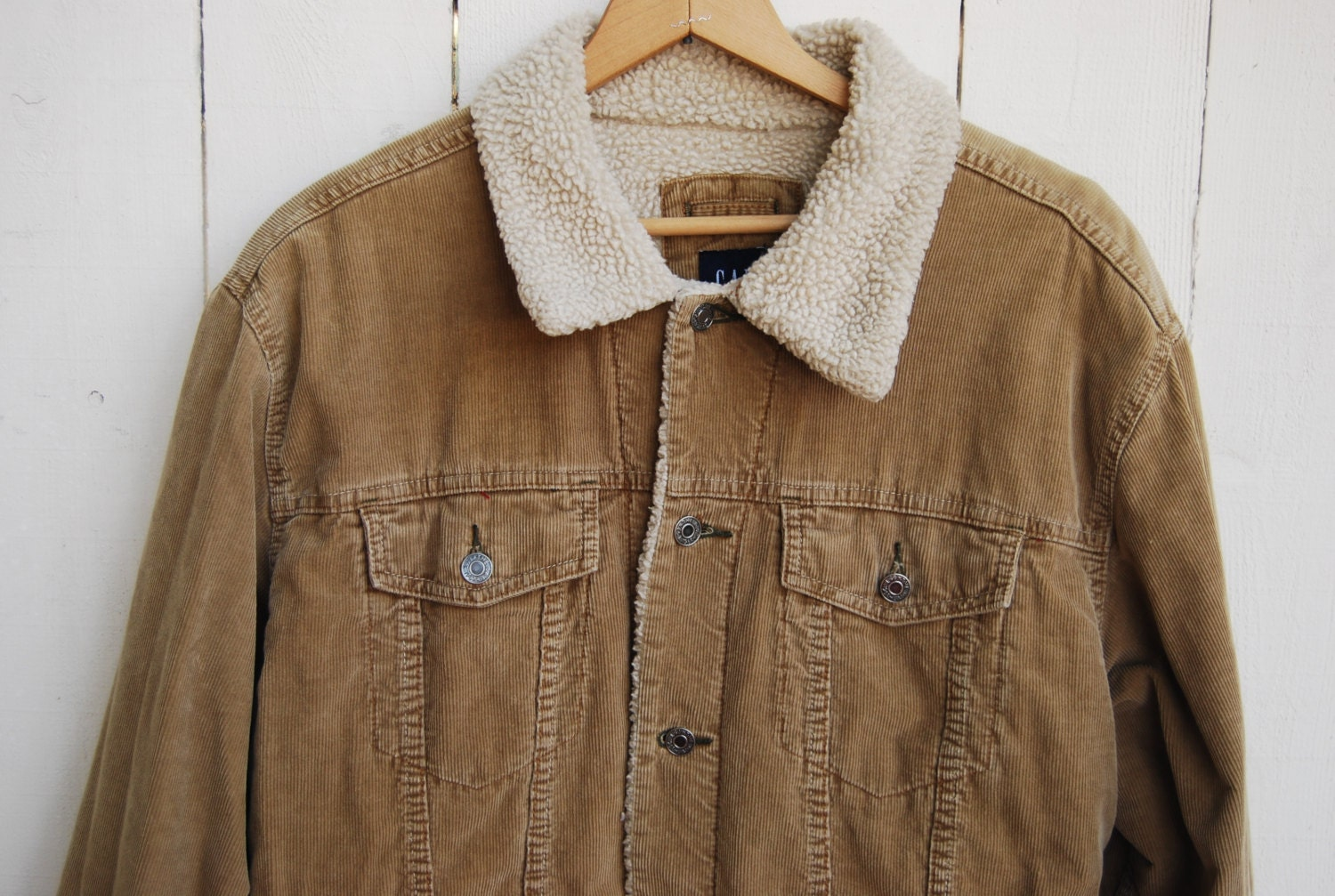Casual warm heavy corduroy textured jacket by Jones New York. Jack is made of 99% cotton 1% spandex. Full button down front. Size Large 20 inch bust 19 inch sleeves 26 inches in length Item pictured is the item sold.