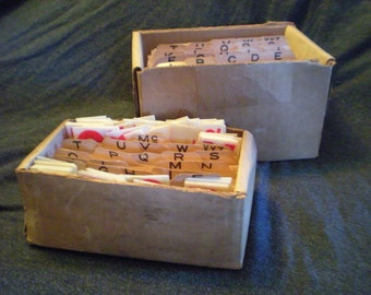 two boxes of vintage letters numbers and symbols