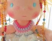 Maya is a 7 inches Waldorf pocket doll.