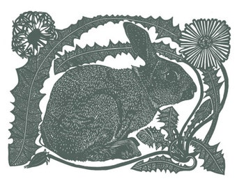 Linocut of a rabbit with a dandelion