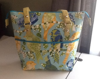 Spring birds purse has outside pockets and bright turquoise cotton lining