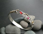 Red garnet bangle bracelet, flowing metalwork, sterling silver, brass details, small size, ring of fire